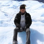 Giuliana seats on Perito Moreno glacier